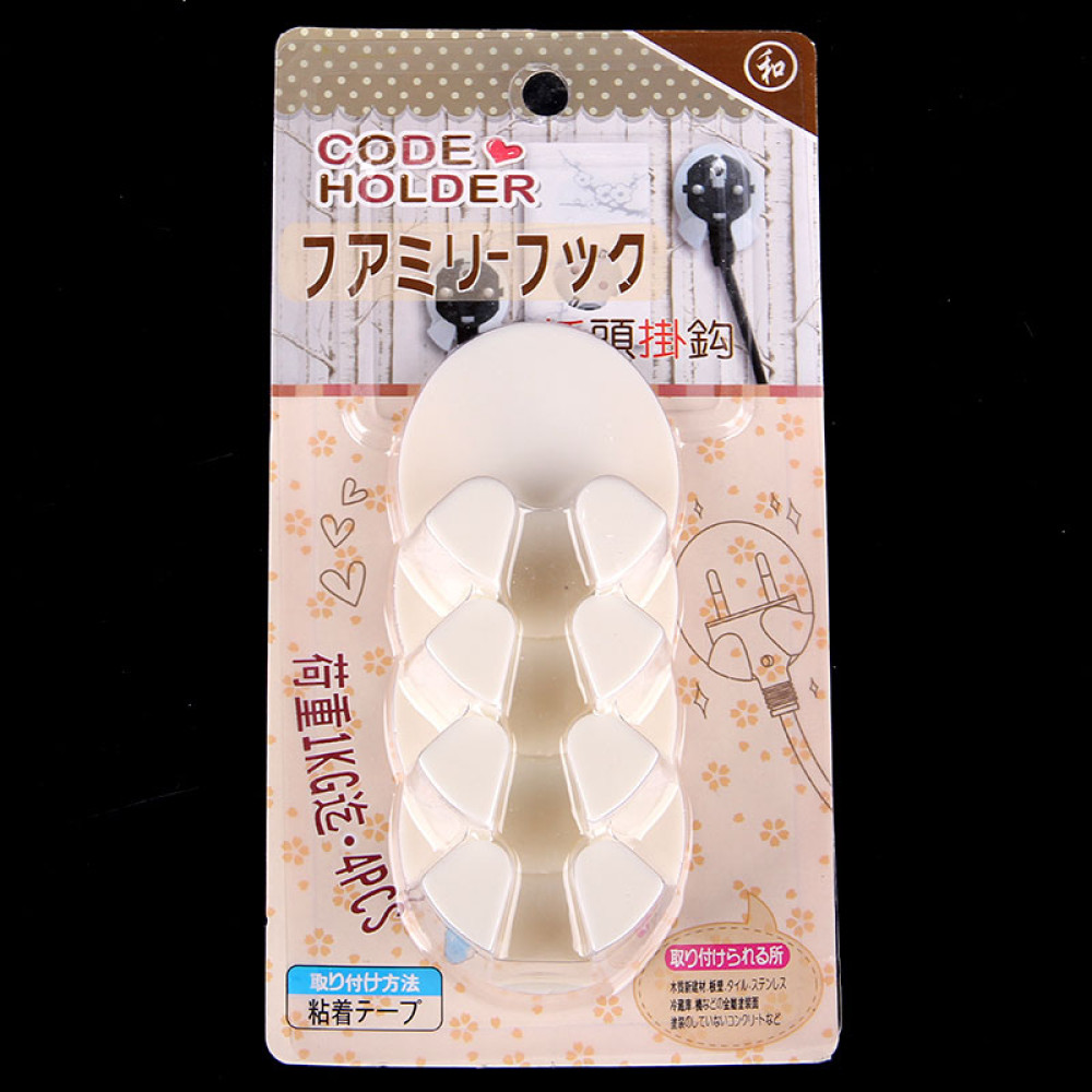 Bộ 4 dụng cụ gác phích cắm điện tiện dụng dính tường Komeki 2396 hàng Nhật